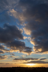 Dramatic sunset with blue sky and clouds