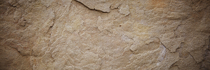 Textured stone sandstone surface. Close up image