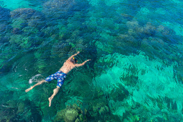 Traveler diving in the sea at Phuket, Thailand.