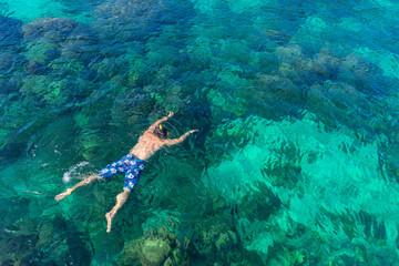 Traveler diving in the sea at Phuket, Thailand.