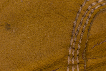 Texture of brown suede with threads