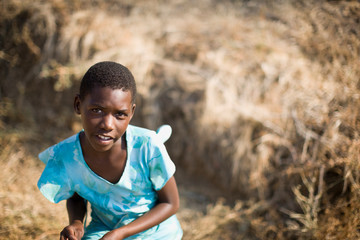 Portrait of a teenage girl on a field.