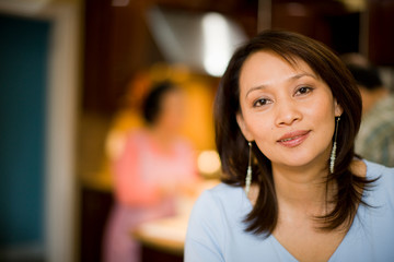 Confident mid adult woman in kitchen