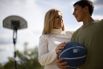 Mother and son on basketball court