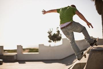 Teenage boy skating at skate ramp