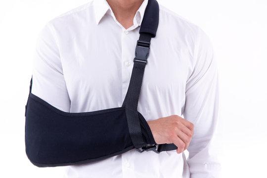 broken hand wearing an arm brace