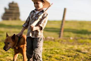 Boy playing cowboys and indians.