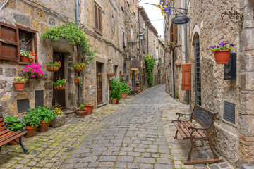 Fototapete - Beautiful alley in Bolsena, Old town, Italy