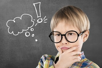 Portrait of a cute young boy with glasses isolated on