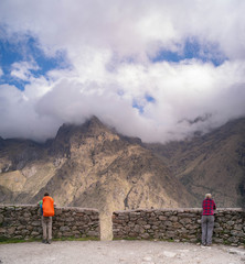 Trekkers stop to admire the rugged mountain scenery