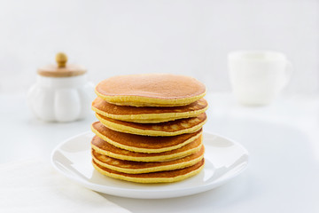 American pancakes on a white plate