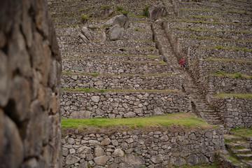 A man hikes down the hillside