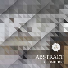 Abstract geometric background from gray triangles with a diagonal shadow.