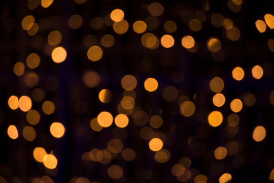 Bokeh golden blurred background. Abstract creative yellow bokeh background
