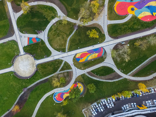 Paths in the park of paving slabs, top view of the city park.