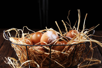 Egg. Fresh farm eggs in basket. Easter egg with feather concept