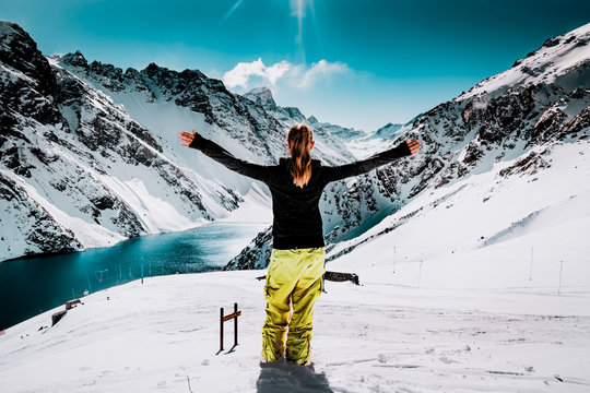 Snow Ski Luxury Resort & Blue Crystal Background. Cute Woman in Mountain. Young Girl in Winter Plateau, Austria. Snowboarding in Winter Holidays. Adventure. Snow Mountain Alps from Peak. Winter Ski.