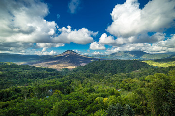 Panorama of Gunug Batur volcano at clouds on Bali island, Indonesia