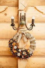 christmas wreath decoration on the wooden wall