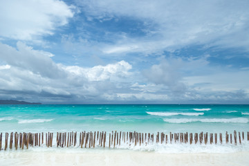 Tropical seascape with turquoise azure sea and white sandy beach in Boracay, Philippines
