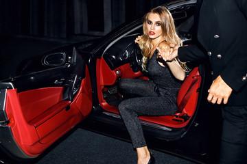 Beautiful girl in the car. Night life.