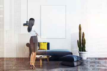White living room, sofa and poster, woman