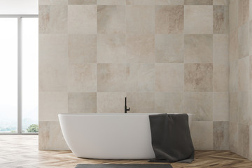 Beige tile bathroom with tub