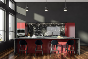 Gray and red kitchen interior with bar