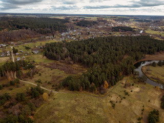 drone image. aerial view of rural area with snake river in forest