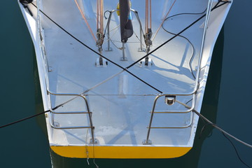 Stern of composite racing sailing ship with stainless steel pushpit and some rigging visible. Craft...