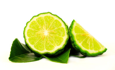 Close up a cut half of Bergamot fruit and leaf on white background which it use for famous Asian herbal ingradient of food such as Chili paste and hair treatment.