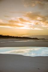 Beach photography - blue ocean waves, sand, overcast sky