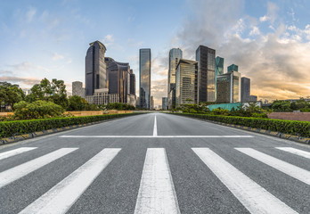 Fotomurales - empty road with zebra crossing and skyscrapers in modern city.