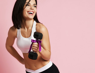 New spring sport workout concept for woman day 8 march. Girl working out with big weight dumbbell laughing