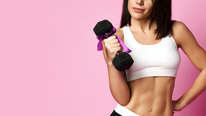 New spring sport workout concept for woman day 8 march. Girl working out with big weight dumbbell