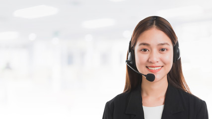 Portrait of Asian beautiful smiling woman customer support phone operator in office space banner background and copy space.Concept call center job service. Wall mural