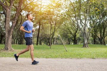 Runner man run in park, exercise and worm up concept