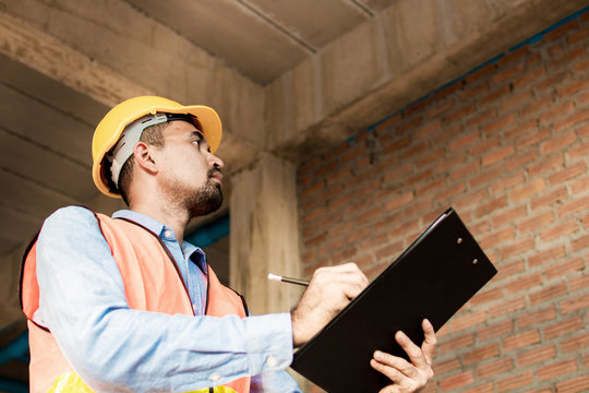 Engineer or inspector checking progressing work in construction site