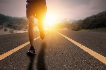 Goal and Strive concept, Runner run on road with sun rising.