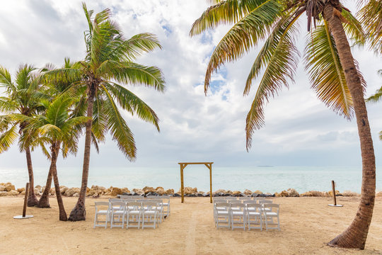 Wedding on beach chairs and altar venue for ceremony background.