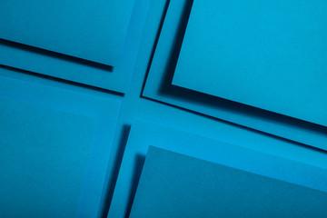 Blue paper material design. Geometric unicolour shapes