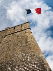 French flag on the wall of an old fort in Saint-Malo