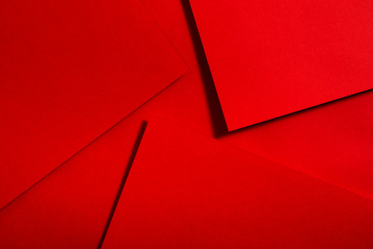 Red paper material design. Geometric unicolour shapes