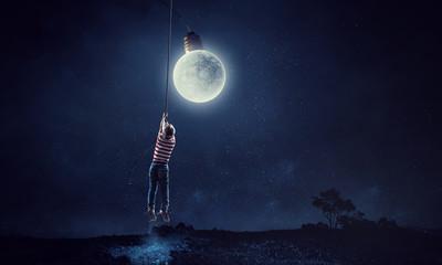 Boy holds the moon . Mixed media