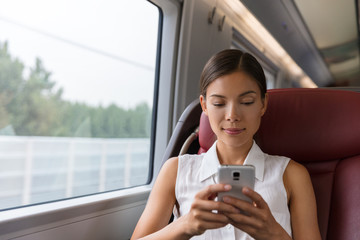 Train commute first class woman using phone texting on mobile phone app work on online wifi device. Asian businesswoman commuter professional. Transport travel lifestyle.