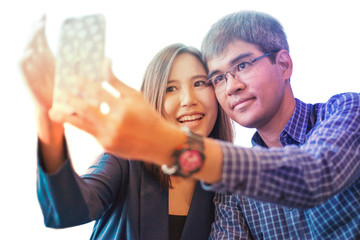 A Couple love spending free time for taking selfie photo by his mobile phone. Photo on white background