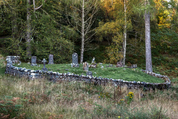 Old Graveyard with Graves of Stone in Loch Garry Highlands in Scotland