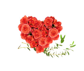 Red rose flowers in a heart shape arrangement with eucalyptus leaves