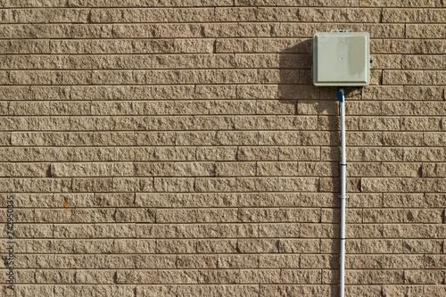 Rough textured tan brown stone brick wall abstract