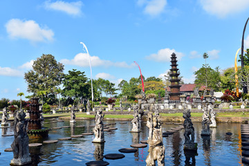 Tirta Gangga former royal water palace. Summer landscape with famous park, Bali Island, Indonesia